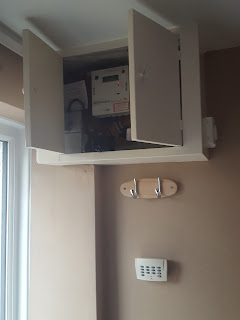 The Old Fuse Board and Electricity Meter in a Cupboard