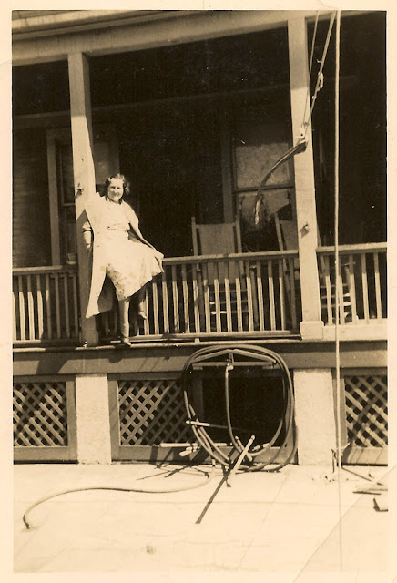 "Hazel Dixon, youngest child of Wiliam A. Dixon and Mary E. Klein. Born 1909. This photo shows Hazel sitting on a porch railing ""@ 120."" Exact location unknown. The photo was taken in April of 1936 according to the inscription on the back. Colleciton of E. Ackermann."