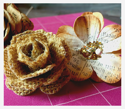 Roses made from burlap and second flower made by stamping on cardstock with distressed edges