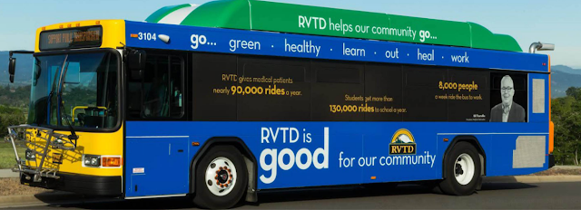 Bus emblazoned with slogans on its side that read, 'RVTD helps our community go ... Go ... green, healthy, learn, out, heal, work. RVTD gives medical patients nearly 90,000 rides a year. Students get more than 130,000 rides to school a year. 8,000 people a week ride the bus to work. RVTD is good for our community.'