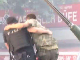 , Touching images of a Policeman coming to save a soldier in Turkey goes viral, Latest Nigeria News, Daily Devotionals & Celebrity Gossips - Chidispalace