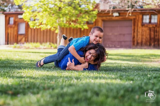 A fun and playful portrait of a brother and sister at a park