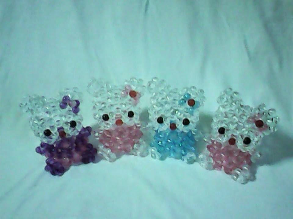 "<img src=""beads4.gif"" alt=""kitty key chains made of beads "" />"