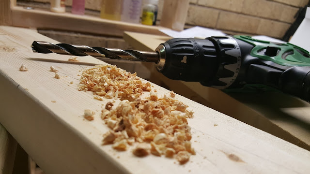 closeup of drill with sawdust