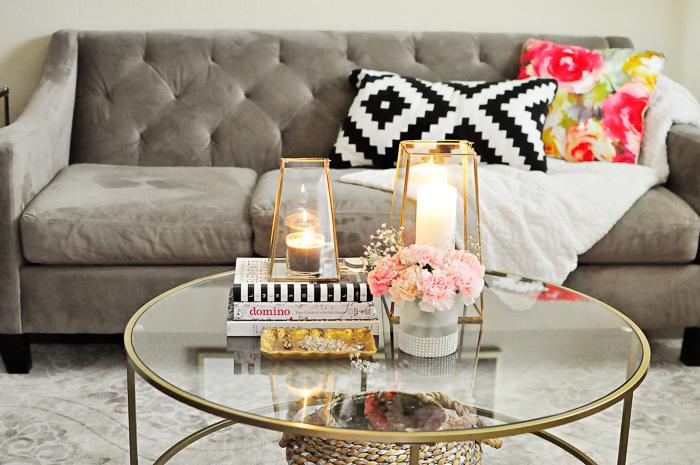 A small apartment living room gets a makeover in a few hours for under $200 with a new rug and gold decor from Better Homes and Gardens.
