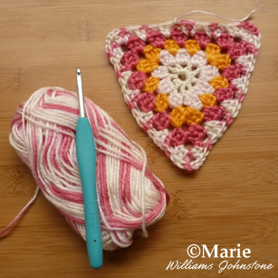 A completed crochet granny triangle section ideal for bunting and pennant banners craftymarie.com free instructions tutorial