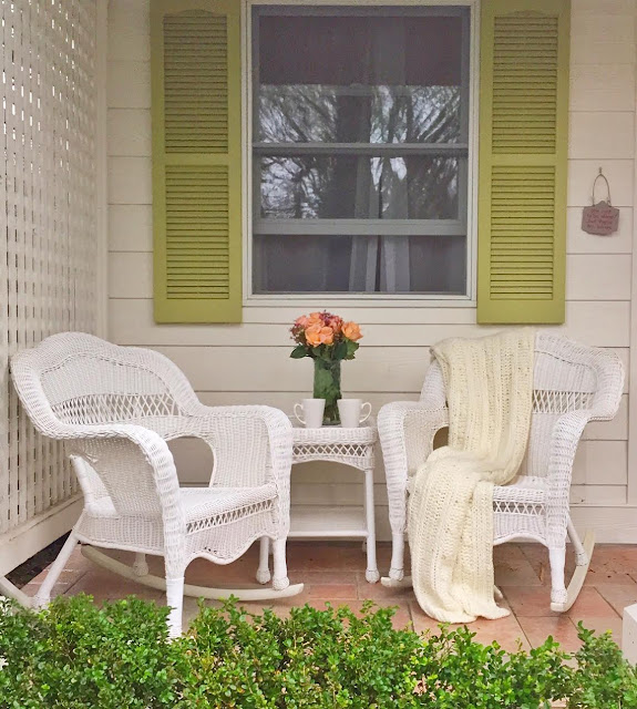 White wicker chairs on porch