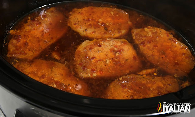 crock pot boneless pork chops cooking in sauce