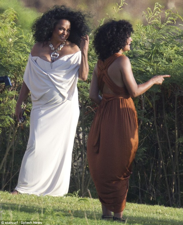 Diana Ross shows cleavage as she attends daughter's
