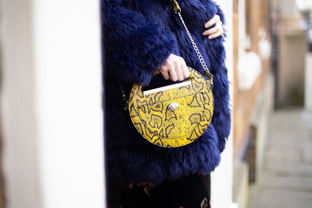 Yellow and Black snake print circle bag from Primark