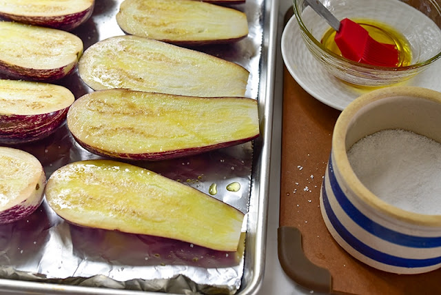 Eggplant halves with oil and salt
