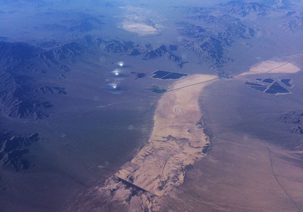 All three towers, at Ivanpah Solar Power Facility near Las Vegas, glow as seen from airplane (Source: Palmia Observatory)