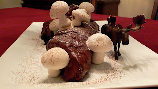 chocolate yule log with plastic moose