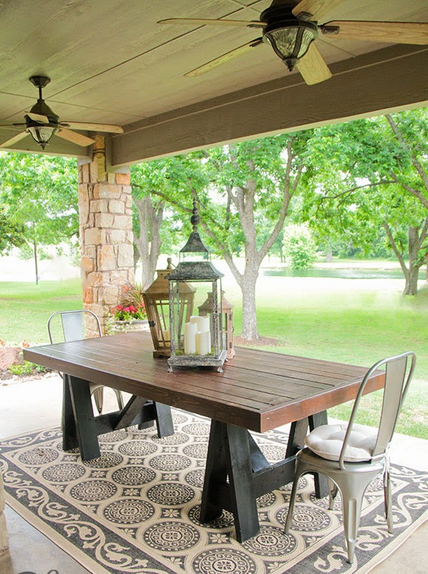 outdoor dining table with metali  legs  metalic chairs