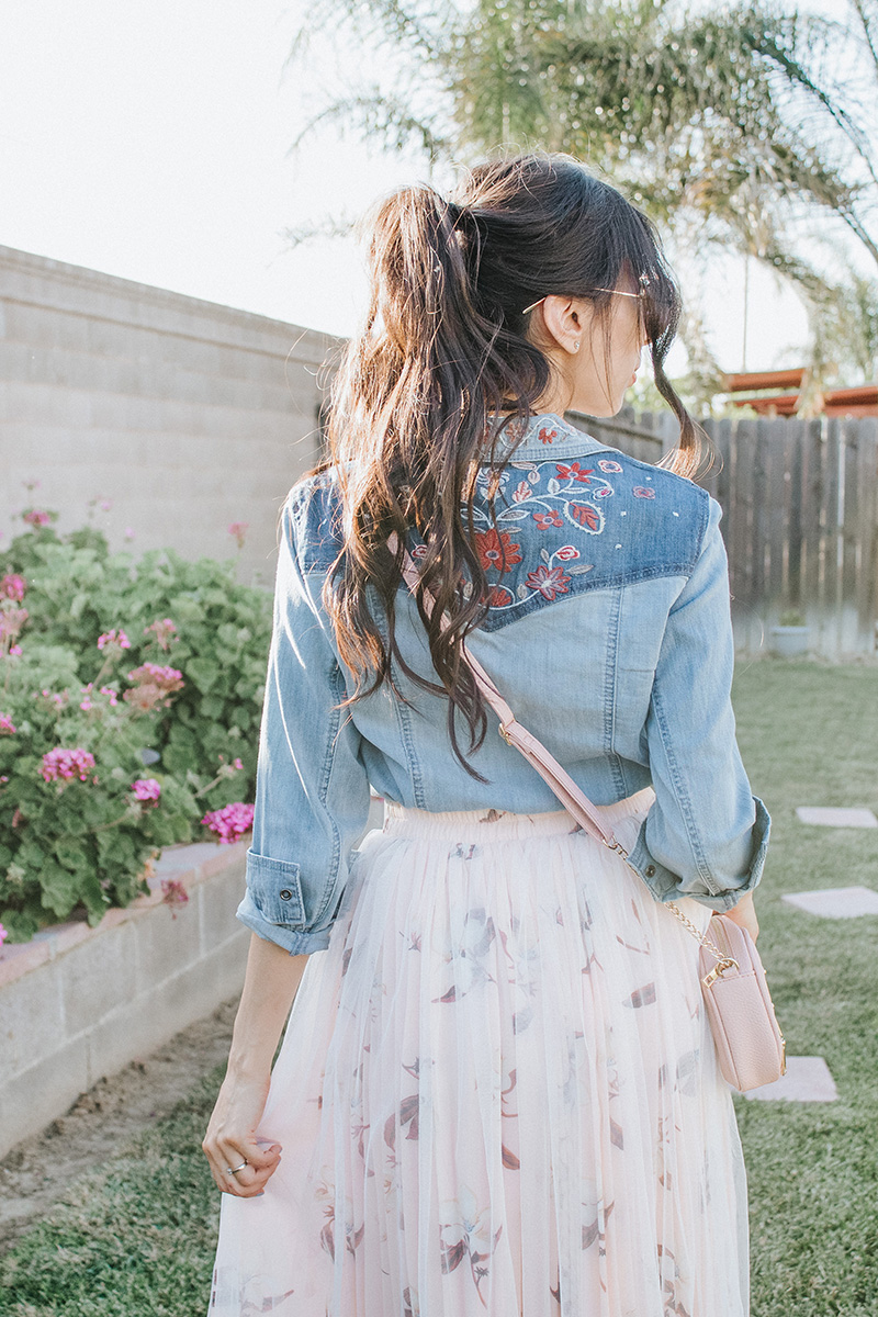 back of embroidered chambray shirt and blush tulle skirt
