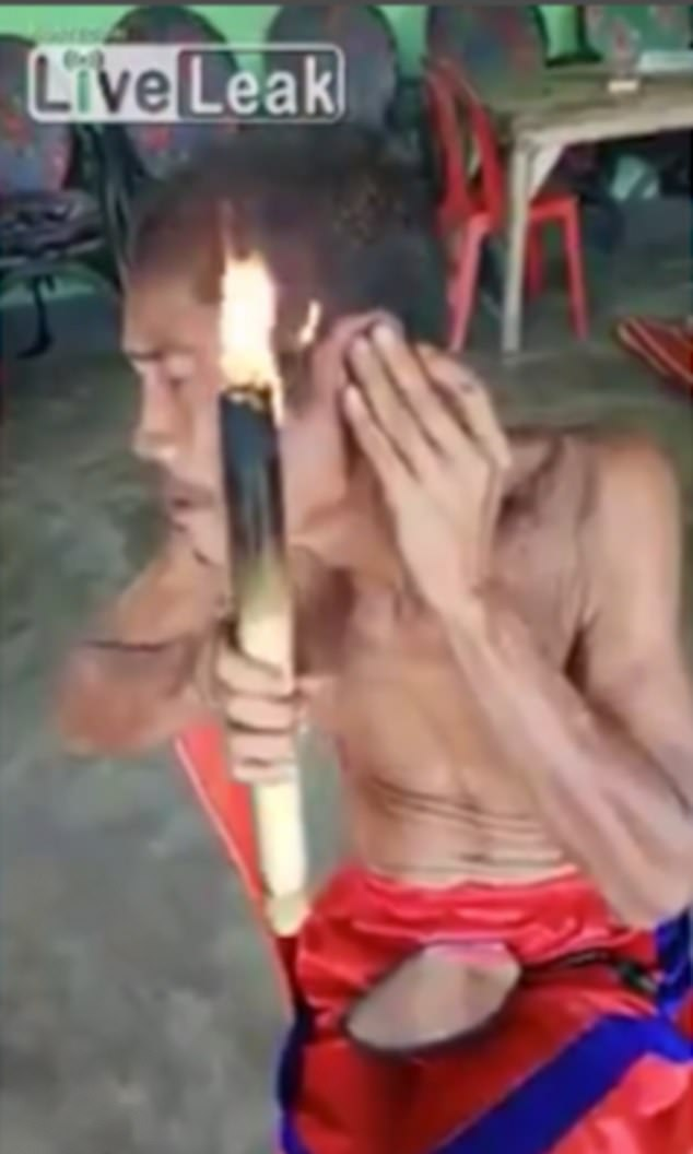 PHOTOS: Man uses fire to give himself a hair cut in Brazil