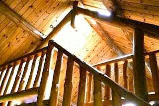 Cottage with wooden ceiling beams.