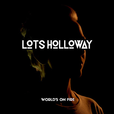 Lots Holloway Premieres 'World's On Fire' Video