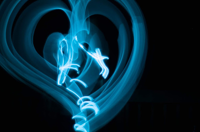 A light painting of a blue heart