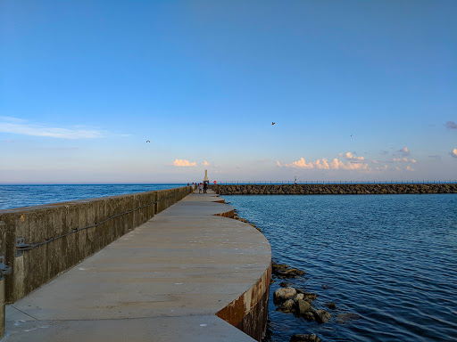 Concrete breakwater and walking route into the marina
