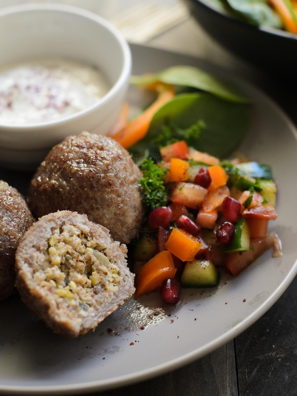 Chicken Kibbeh serve with  tahini yoghurt sauce and salad