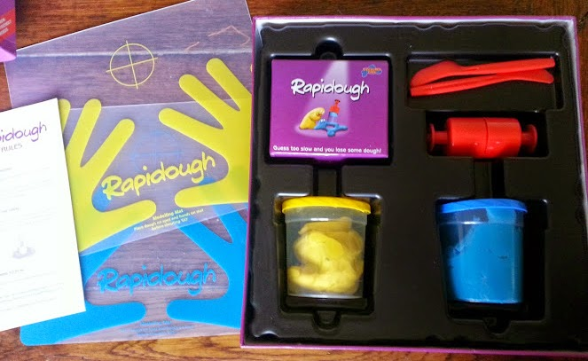 Rapidough box contents including dough and plastic mats
