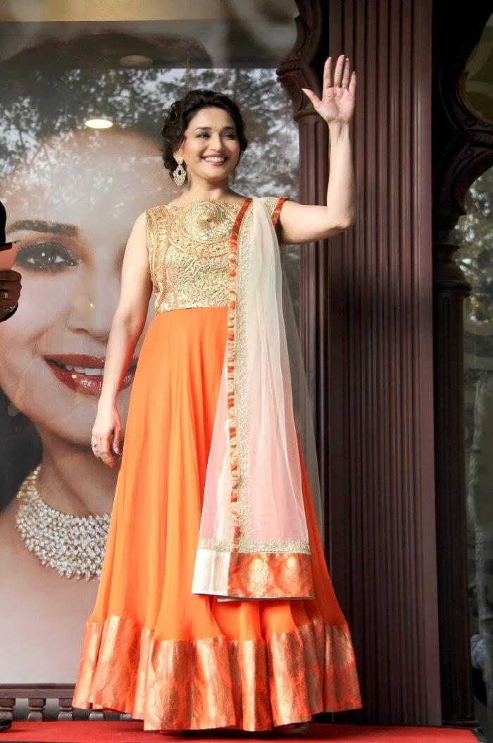 Bollywood Actress Madhuri Dixit Stills in Orange Dress
