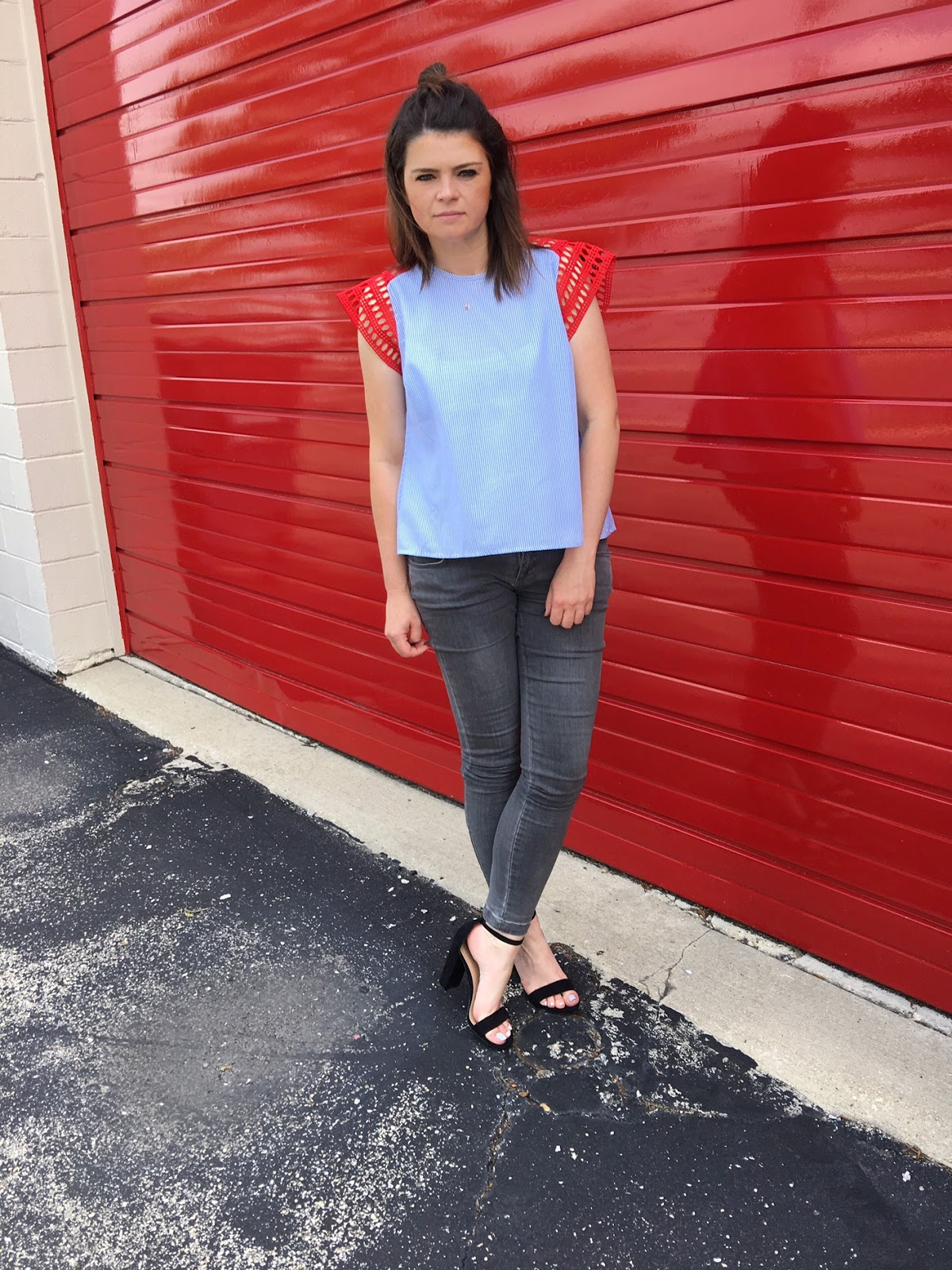 A blue top with red eyelet sleeves