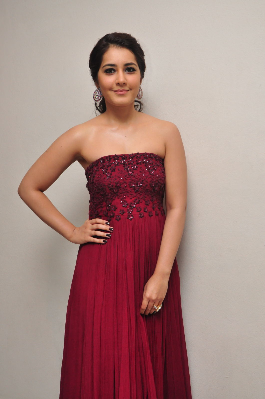 Rashi Khanna Photos At Movie Success Meet In Maroon Gown