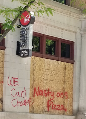 Vandalized stores on State Street.