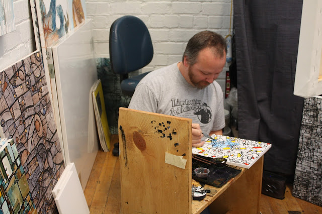 Painter Dan Johnson creating in his studio at The Bucktown Center