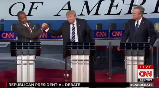 Ben Carson Donald Trump handshake oppose Iraq War