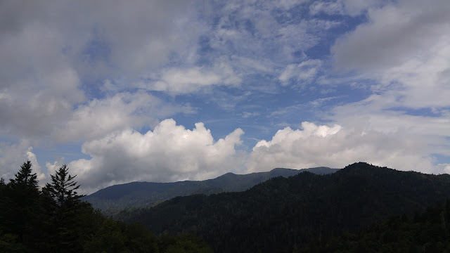 higher elevation clouds and blue skies