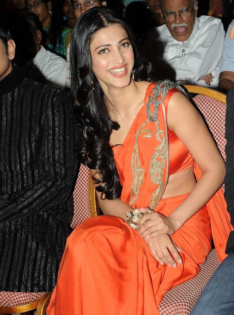 Shruti Haasan Photos In Orange Saree