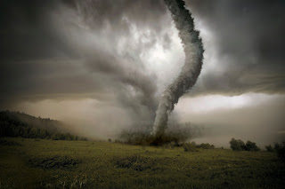 Tornado touching down in field