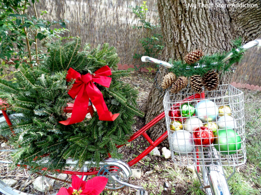 Friday's Find: Clearance Poinsettias to Deck My Halls... mythriftstoreaddiction.blogspot.com My vintage garden bike decorated for Christmas