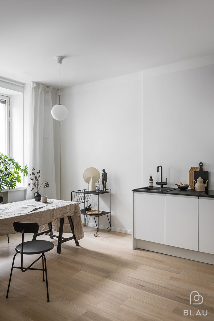 This thing will add an instant cozy vibe to your kitchen. Scandinavian kitchen design and linen tablecloth on the table. Photo via Minna Jones