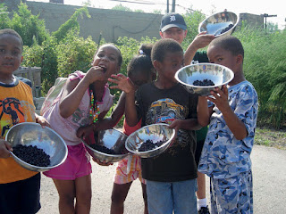 Children in Detroit enjoying locally produced food.