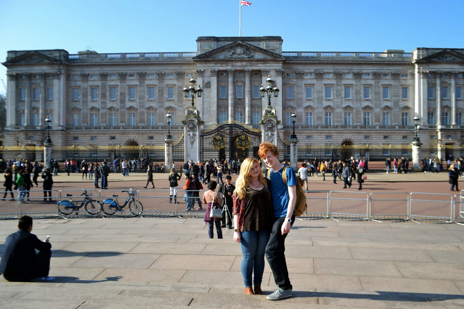 Me and Sean standing in the foreground with buckingham palace behind us