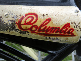 """Columbia"" on side of faux gas tank on bicycle."