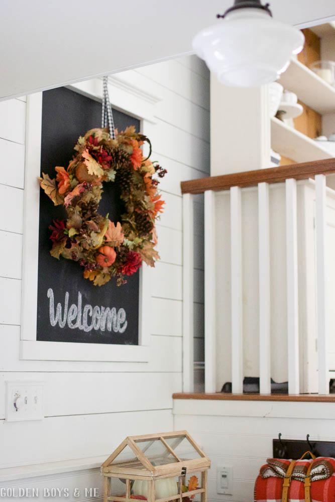 Easy decor idea- add a seasonal wreath to a chalkboard and add a simple greeting with chalk