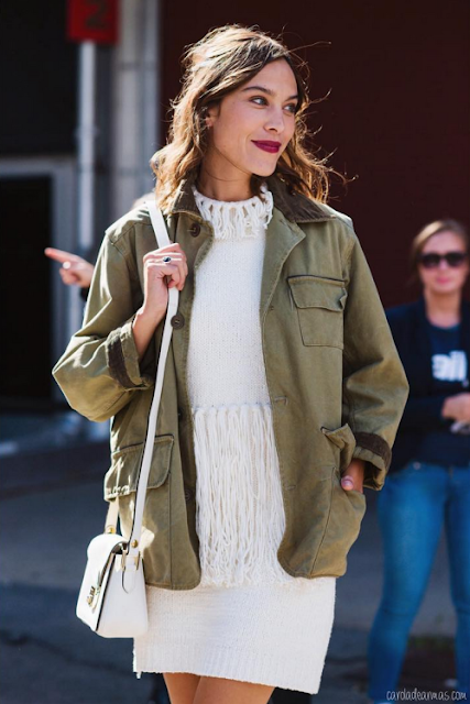 Alexa Chung celebrity street style in a white dress and olive jacket, celebrity wearing a white dress, outfit inspiration from Alexa Chung