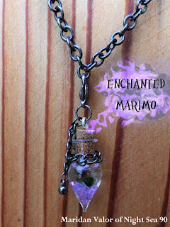 My birthday present to myself. A marimo necklace called 'Enchanted'