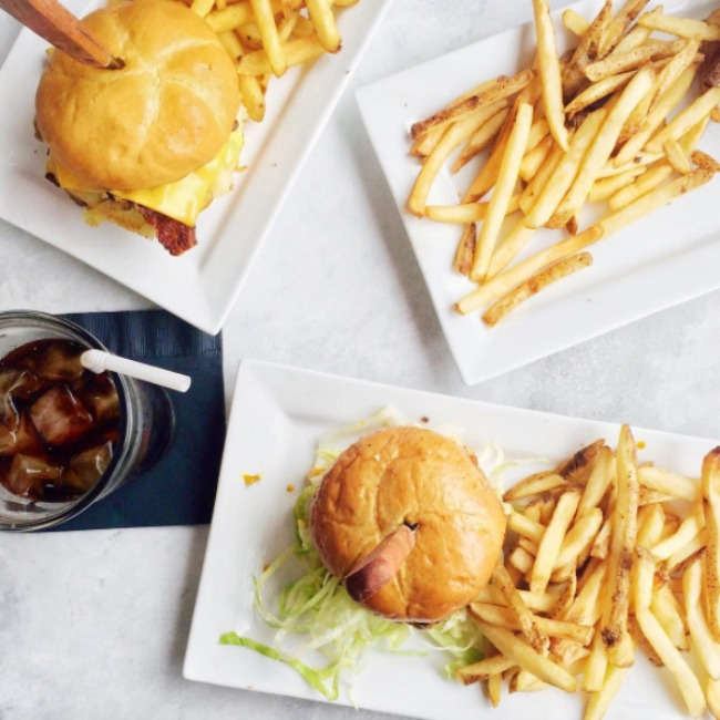 A flat lay of Watsons Diner's burgers and fries from Orange, California
