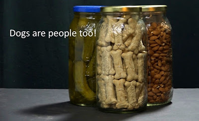 "Pickle jars filled with emergency foods with caption ""Dogs are people too!"""