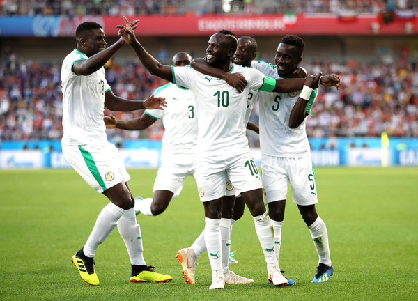 Sadio Mane of Senegal celebrates with teammates after scoring his team's first goal during the 2018 FIFA World Cup Russia group H match between Japan and Senegal at Ekaterinburg Arena on June 24, 2018 in Yekaterinburg, Russia.