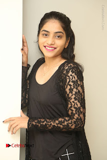 Actress Punarnavi Bhupalam Stills in Black Dress at Pittagoda Press Meet  0029.JPG