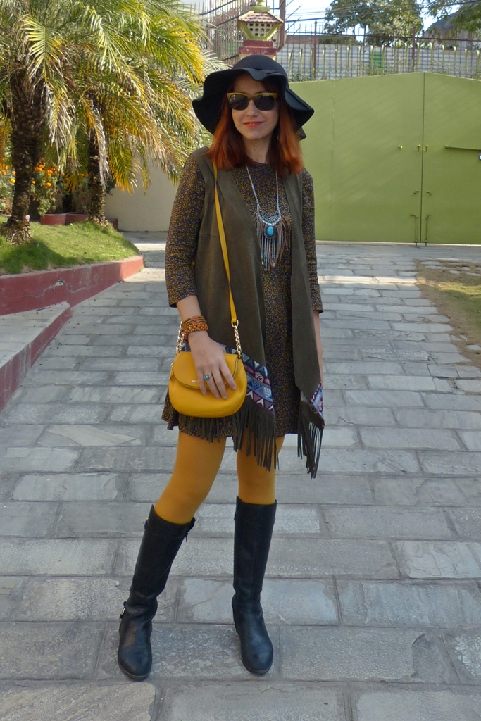 70s inspired look with fringed vest