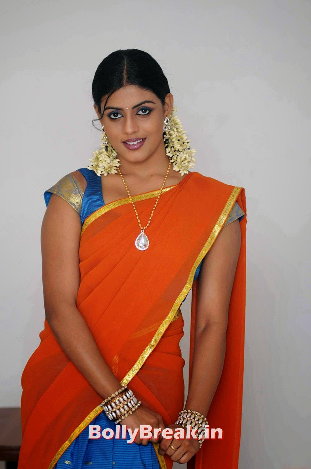 Iniya Pictures, Actress Iniya hot Pics in Orange Saree