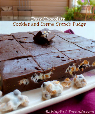 Dark Chocolate Cookies and Creme Crunch Fudge: creamy, chocolate decadence with a surprise crunch in the center. Only takes minutes to make. | Recipe developed by www.BakingInATornado.com | #recipe #chocolate